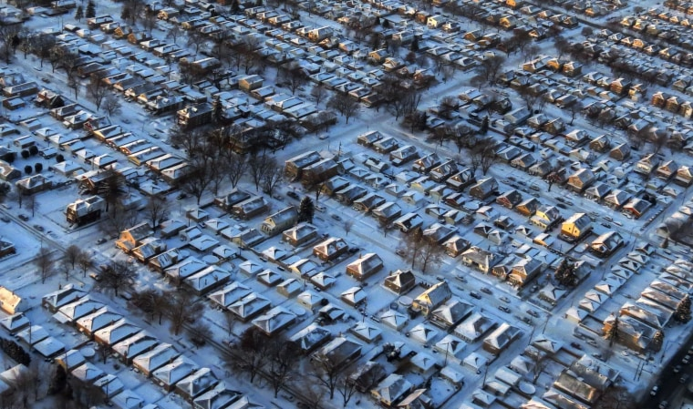 Houses and streets are covered with a blanket of snow in Chicago, Ill., on Jan. 6. A massive blast of bitterly cold air plunged temperatures across much of the USA to life-threatening lows not seen in nearly two decades.