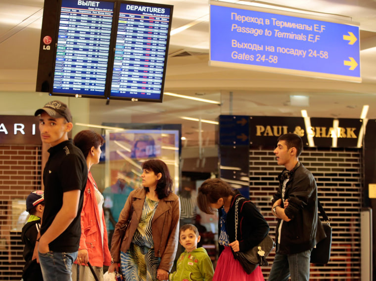 Passengers wait for their flight at Moscow's Sheremetyevo airport