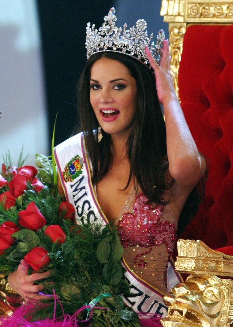 Image: Miss Venezuela beauty pageant winner Monica Spear smiles as she is crowned.