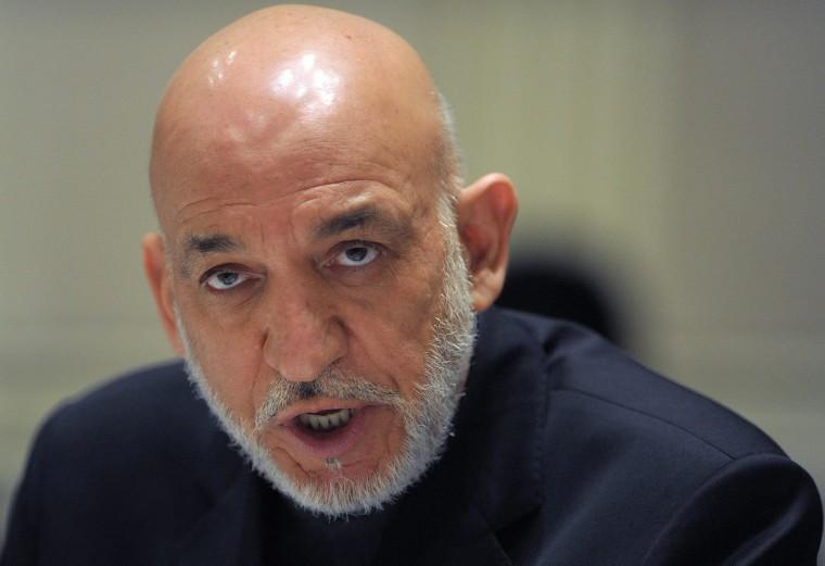Image: Afghan President Hamid Karzai addresses media representatives during a press interaction