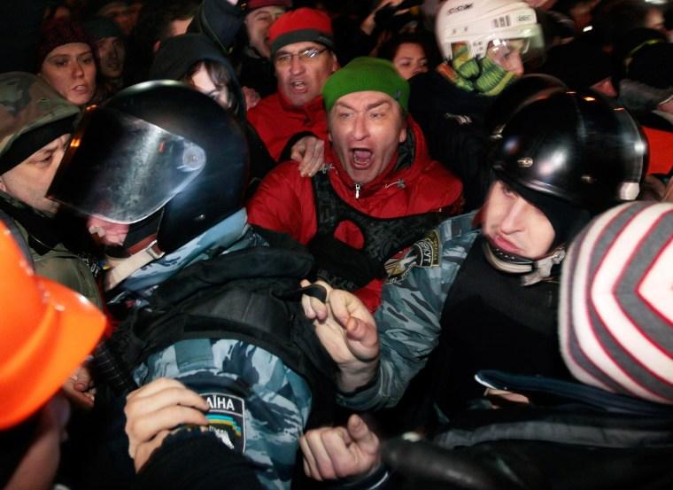 Image: Pro-European Union activists block riot police