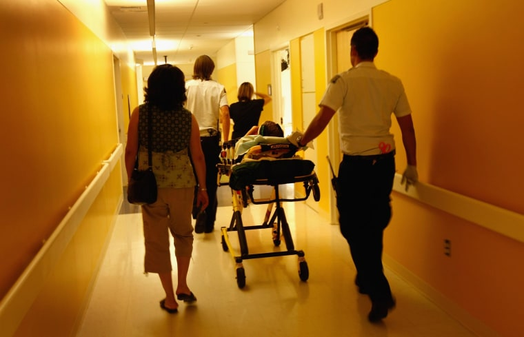 Image: Child being wheeled through the ER