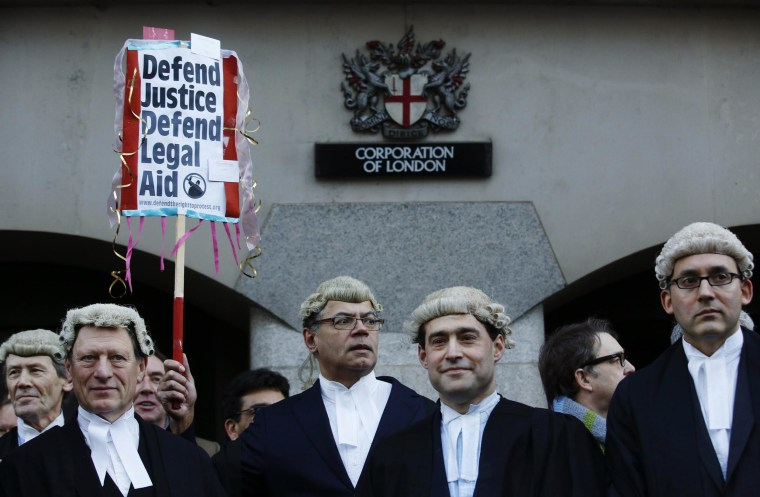 Image: Trial lawyers demonstrate outside the Old Bailey courthouse in London