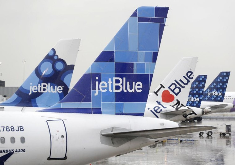 IMAGE: JetBlue airplanes at John F. Kennedy Airport in New York.