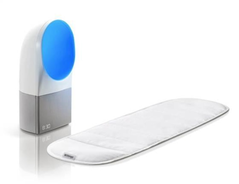 The Aura sleep-tracking device from Withings consists of a mattress pad and a bedside light/clock/sensor combo.