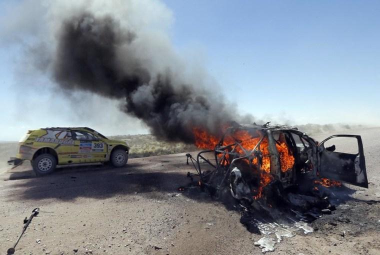 Image: Burning car at Dakar Rally.
