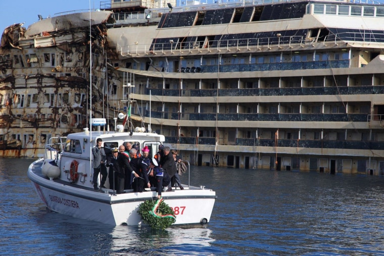 The mayor of Giglio Island laid a wreath at sea for the lives lost when the massive Costa Concordia cruiseship looming in the background capsized two years ago, killing 32.