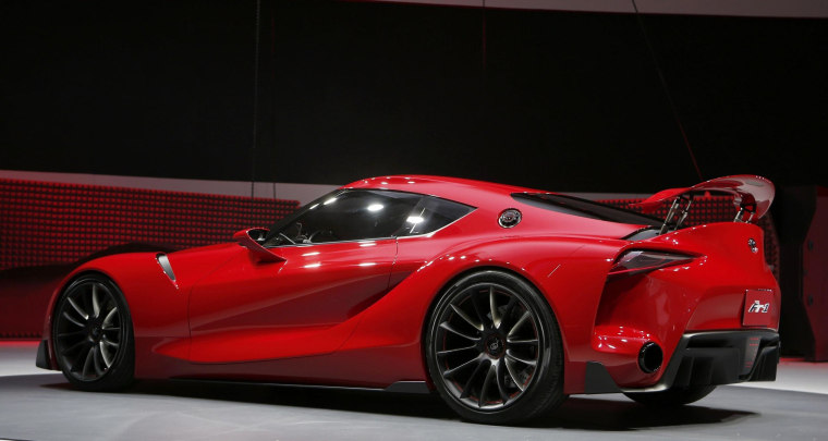 Image: The Toyota FT-1 concept car is unveiled on stage during the press preview day of the North American International Auto Show in Detroit