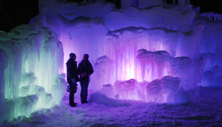 Visitors tour an ice castle at the base of the Loon Mountain ski resort on Jan. 8 in Lincoln, N.H.