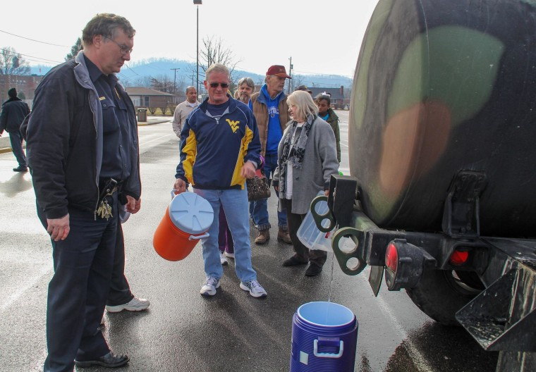 Image: Residents line up for water at a water filling station at West Virginia State University.