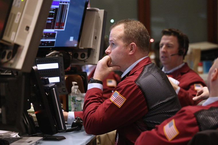 Image: Traders work the floor of the New York Stock Exchange