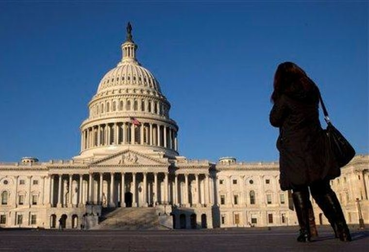 A woman looks on at the Capitol dome.