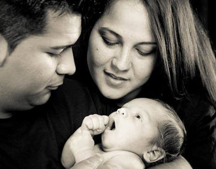 Image: Erick and Marlise Munoz hold their son, Mateo