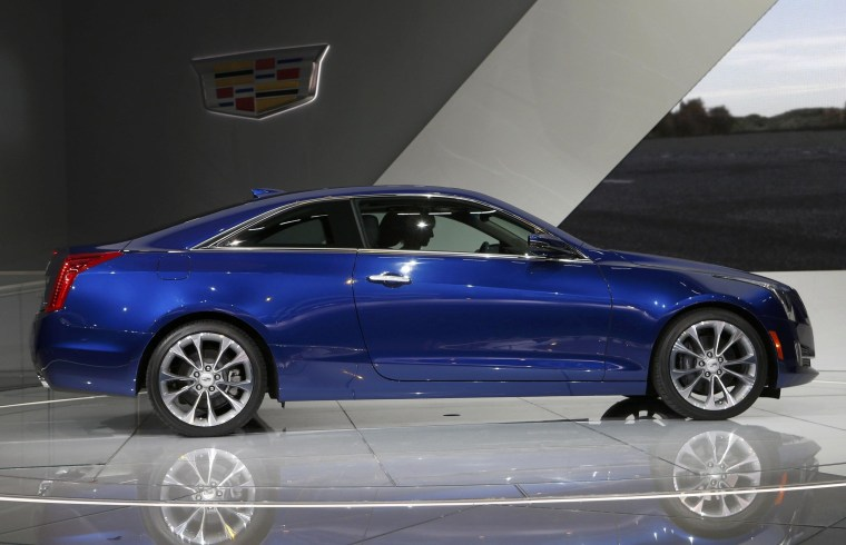 The Cadillac ATS Coupe is unveiled during the press preview day of the North American International Auto Show in Detroit