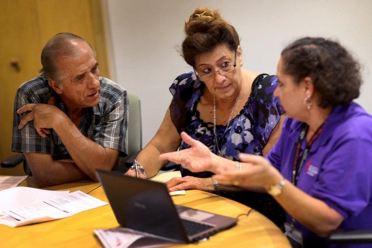 Image: Health navigator Nini Hadwen speaks with Jorge Hernandez and Marta Aguirre