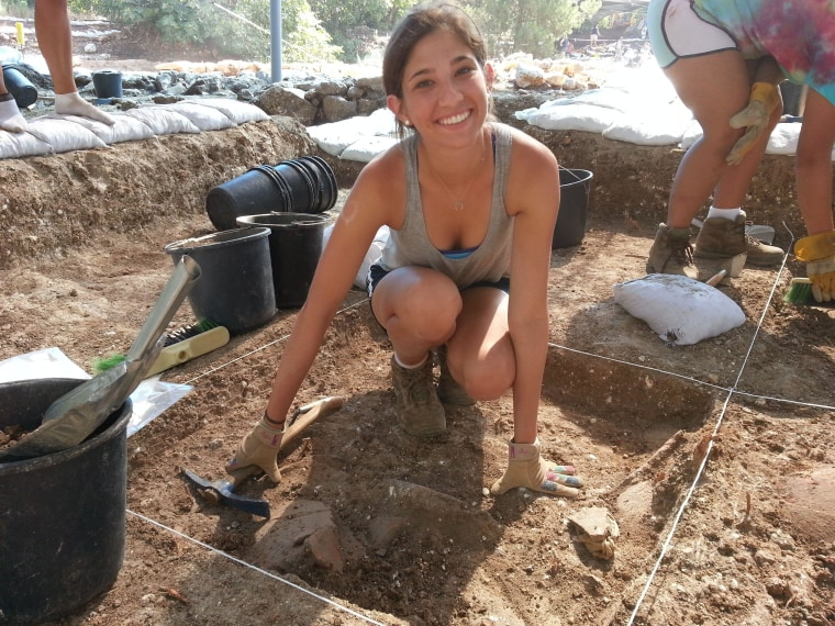 University of Florida volunteer Rachel Kalisher removes soil from a 1-square-meter fine grid marked with string at the Tel Kabri archaeological site in northern Israel. Volunteer archaeology is the January-February cover story for Biblical Archaeology Review.