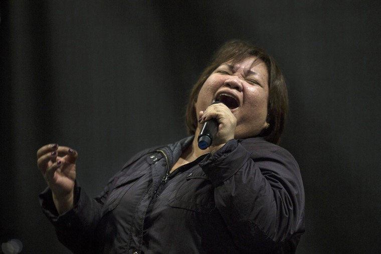 Image: Rose Fostanes, 47, a Filipina caregiver, performs during a rehearsal for Israel's X-Factor talent show in Tel Aviv on Jan. 12.