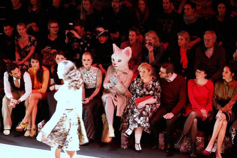 Image: A guest disguised as a cat attends Fashion Week in Berlin