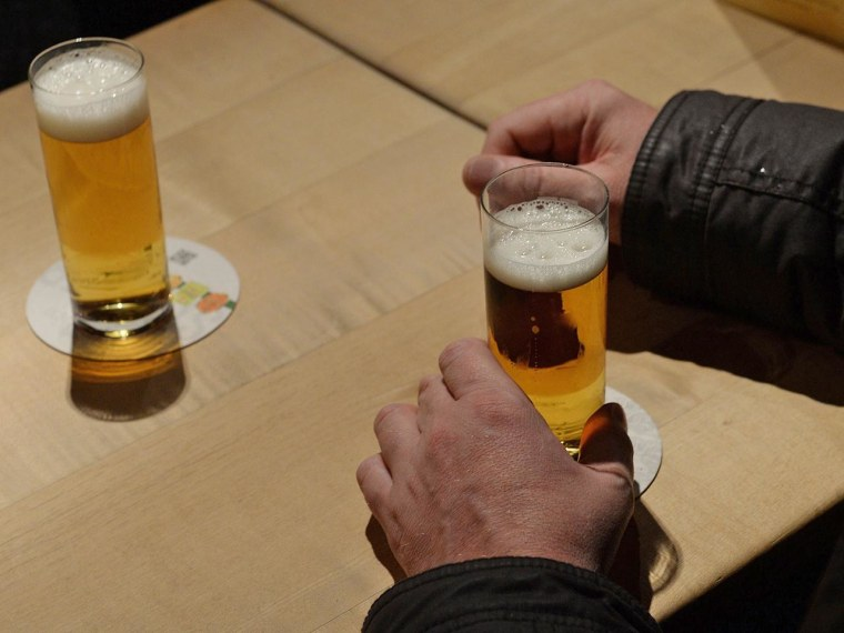 Image: Man drinking beer