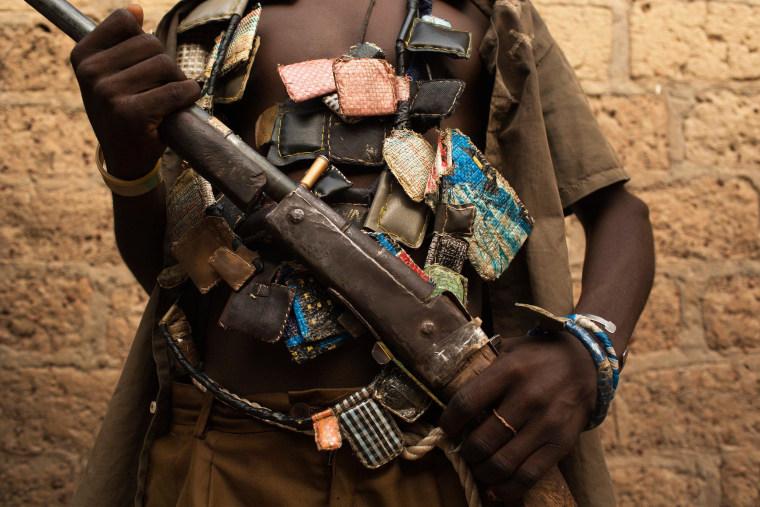 Image: An anti-balaka militiaman holds a gun on outskirts of Bangui, Central African Republic