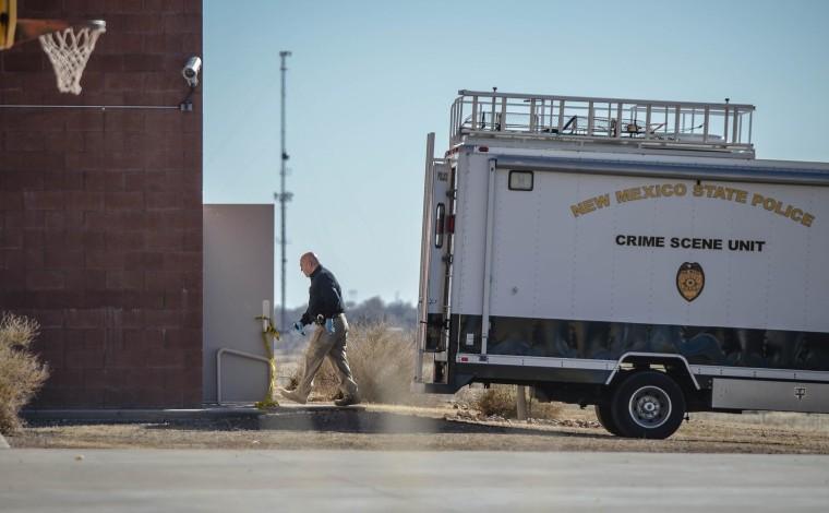 Image: Crime scene investigators enter the gymnasium at Berrendo Middle School
