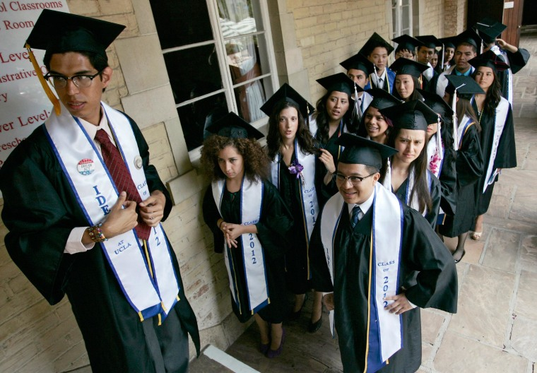 """Undocumented UCLA students stand in line at a graduation ceremony for UCLA """"Dreamers"""", or Dream Act students, at a church near the campus in Los Angeles."""