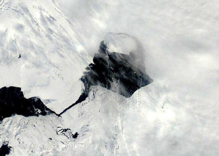 A NASA satellite image snapped Nov. 13, 2013, shows open water between Pine Island Glacier and its massive iceberg.