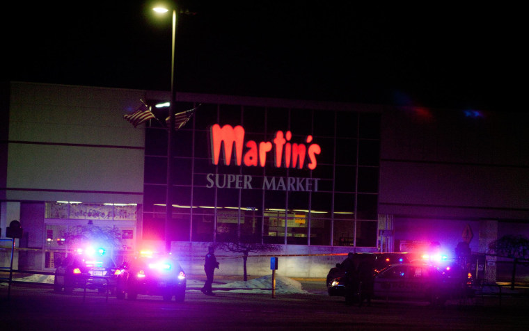 Emergency personnel respond to a shooting inside Martin's Supermarket in Elkhart, Ind., late Wednesday, Jan. 15, 2014. A man fatally shot two women inside the grocery store and was lining up to shoot a third person when police officers tracked him down and killed him, authorities said. Elkhart police received a call about a gunman at Martin's Super Market about 10 p.m. Wednesday, Indiana State Police Sgt. Trent Smith said Thursday. The 22-year-old gunman used a semi-automatic handgun to shoot and kill a 20-year-old employee and a 44-year-old shopper, Smith said. The victims' bodies were found about 12 aisles apart.