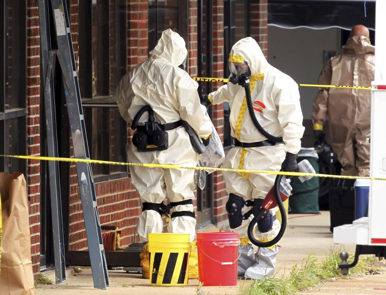 Image: Hazmat officers investigate the taekwondo studio previously operated by Everett Dutschke in Tupelo