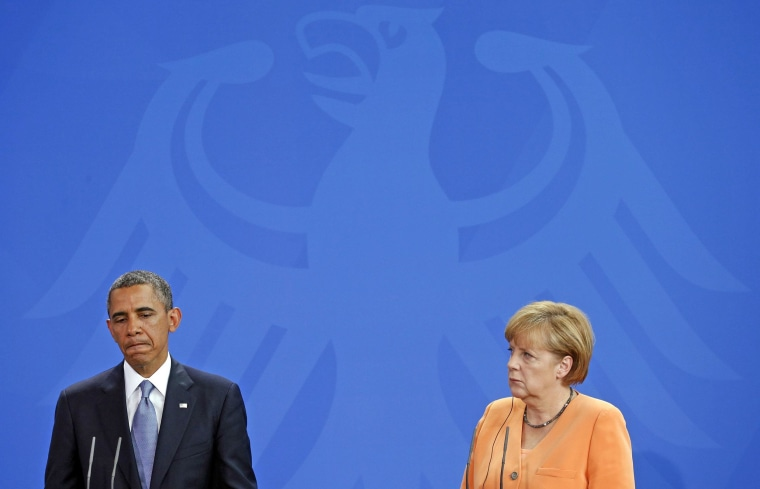 Image: President Barack Obama and German Chancellor Angela Merkel holding a joint news conference at the Chancellery in Berlin on June 19, 2013.