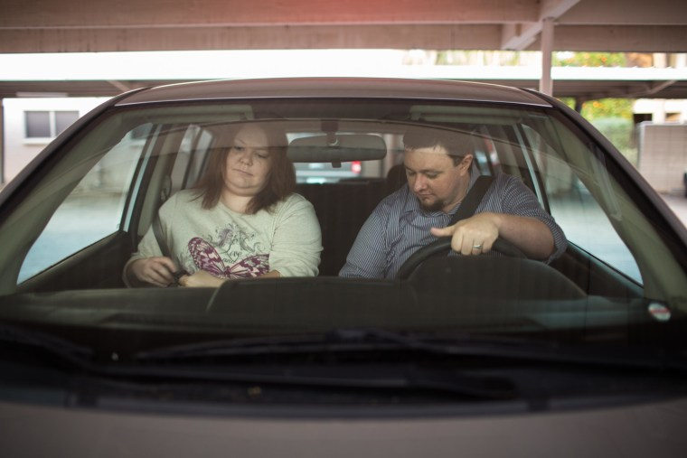 Erika and Ben Trowell leave their apartment in Phoenix, Ariz., to head to work. The couple shares a car because they can't afford another one.