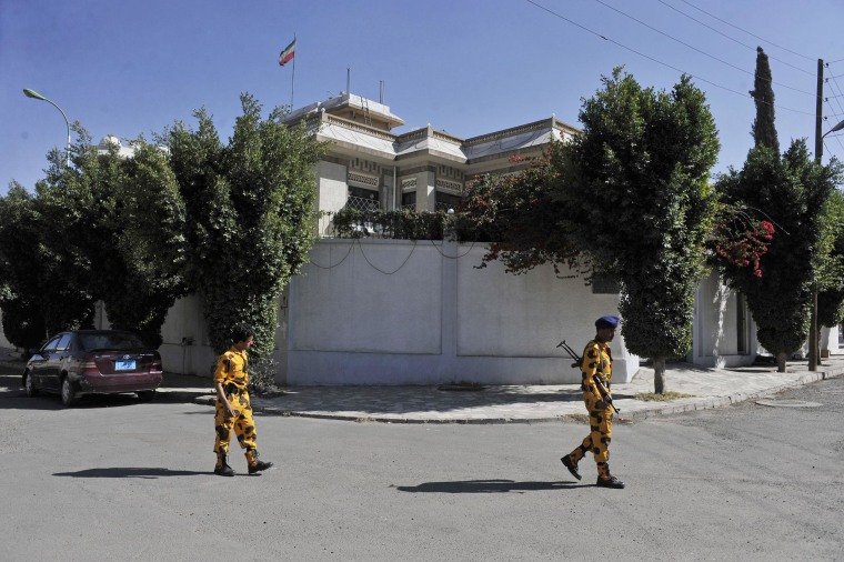 Image: Yemeni soldiers stand guard in front of the Iranian ambassador's residence in Sanaa, Yemen, on Saturday.