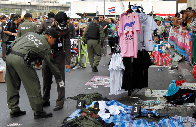 Image: Police officers check the scene where an explosion took place near a camp of anti-government protesters at the Victory Monument in central Bangkok