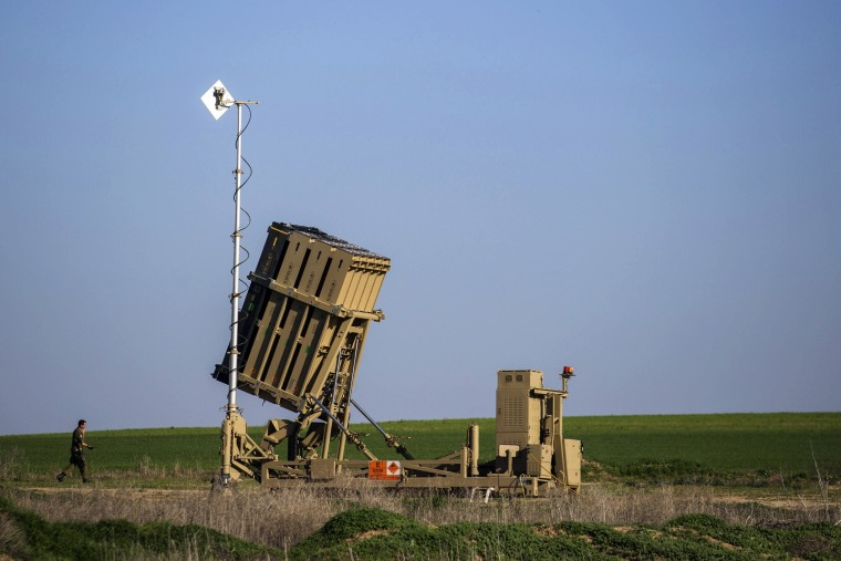 Image: An Israeli soldier walks near the launcher of an Iron Dome missile interceptor battery deployed in the southern Israeli coastal city of Ashkelon