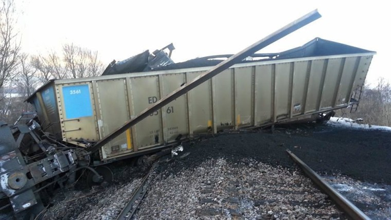 Image: Derailed rail cars in Caledonia, Wis., on Sunday morning.