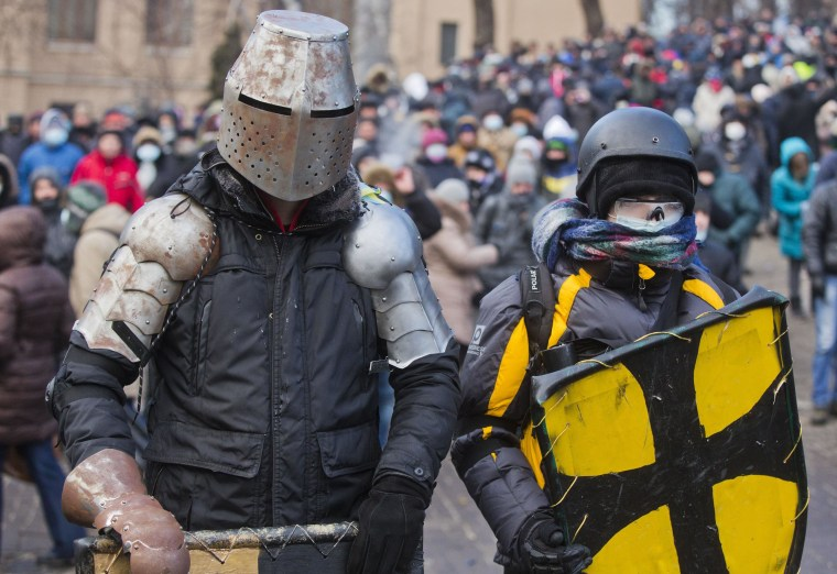 Image: Protesters clad in improvised protective gear prepare for a clash with police in central Kiev