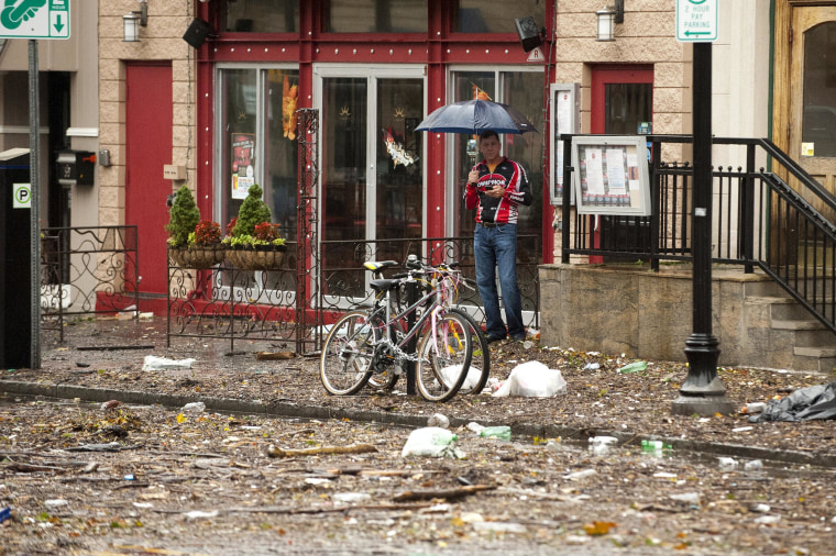 Image: A man surveys the damage from Hurricane Sandy on Oct. 30, 2012 in Hoboken, N.J.