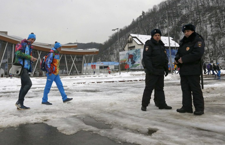 Image: Police officers stand guard outside a train station near Soch, Russia, on Jan. 17.