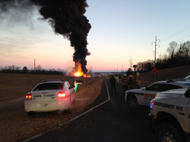 First responders watch as a fire rages at a bio-diesel facility in New Albany, Mississippi