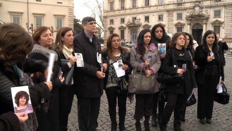 Image: A group of Italian mothers who claim their children died of cancer after being poisoned by tons of toxic waste dumped by the local mafia gather outside Italy's presidential palace in Rome Wednesday.