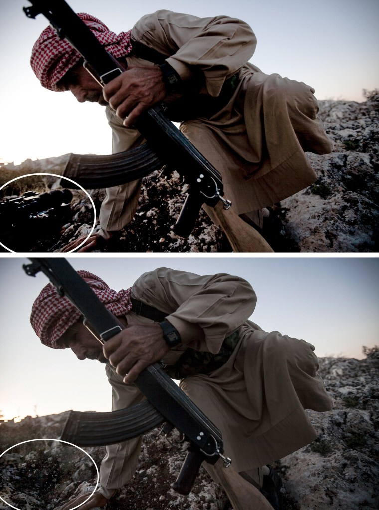 Image: A Syrian opposition fighter takes cover during an exchange of fire with government forces in Telata village.