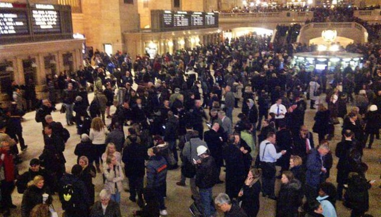 Metro-North commuters at Grand Central Terminal wait for service to be restored Thursday night.