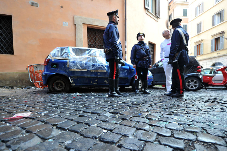 Image: Carabinieri stand near the church Saint-Yves des Bretons after a small explosive device went off