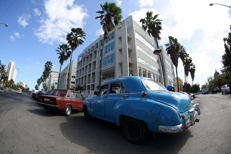 Vintage American cars parked outside the Miramar Trade Center in Havana, Cuba