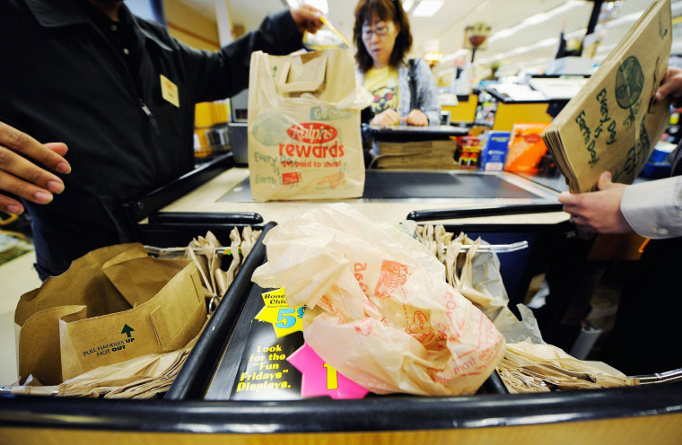 Image: Customers of Ralphs supermarket use plastic bags to carry their groceries home in Glendale, California.