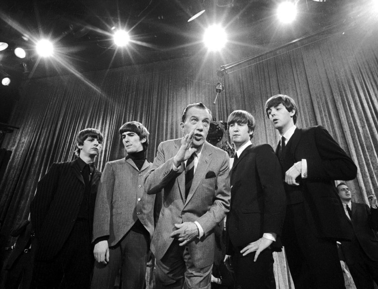 Image: Ed Sullivan, center, stands with The Beatles during a rehearsal for the British group's first American appearance on Feb. 9, 1964.