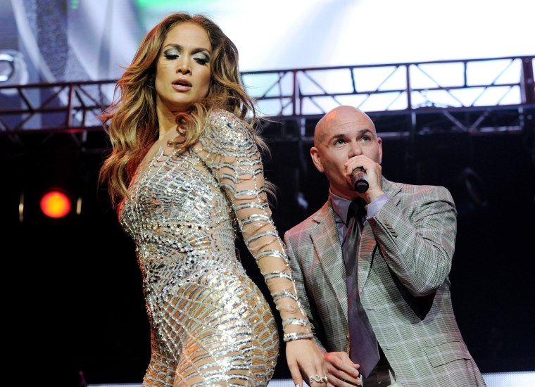 Image: Singers Jennifer Lopez, left, and Pitbull perform at KIIS FM's Wango Tango at the Staples Center on May 14, 2011 in Los Angeles, California.