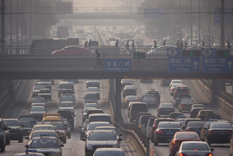 This Nov. 25, 2011, photo shows heavy midmorning traffic amidst air pollution in Beijing, China. While some European cities are pondering going carless, or at least reducing traffic, emerging markets also are grappling with the matter. Beijing, Shanghai and a number of other Chinese cities have been enacting rules to reduce the number of new vehicles that can be sold and registered.