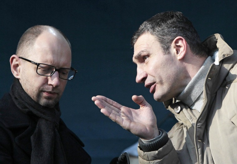 Opposition leaders Vitali Klitschko, right, and Arseniy Yatsenyuk speak at a pro-European Union rally in Kiev on Dec. 29, 2013.