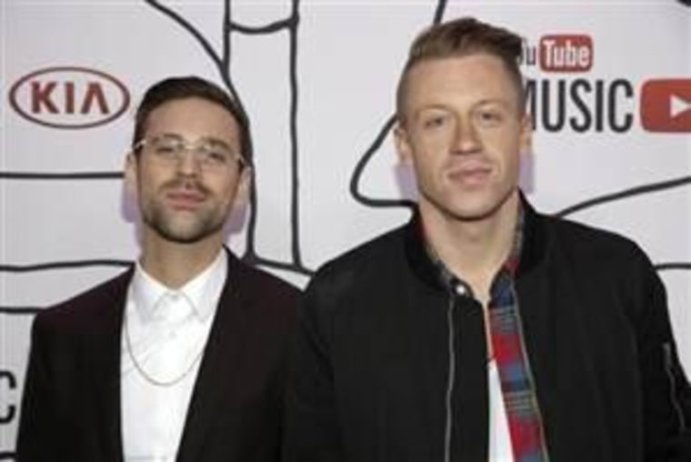 Ryan Lewis (L) and Macklemore attend the YouTube Music Awards in New York November 3, 2013.